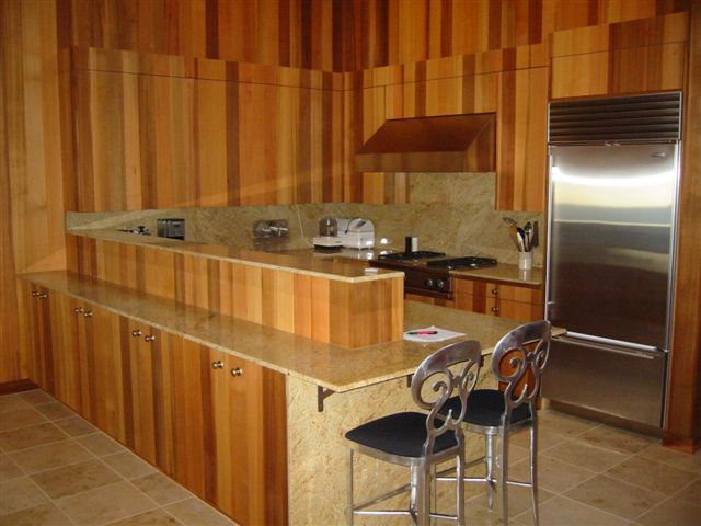 Image Of A Kitchen With Western Red Cedar Paneling And Cabinets Matched For Grain