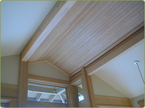 Image of hemlock posts and beams, also featured is clear grade hemlock ceiling paneling
