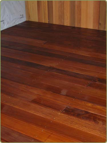 image of just oiled ipe flooring drying out