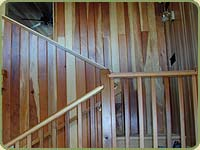 small image of stairs and redwood wall paneling