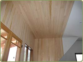 image of a wall with hemlock paneling.