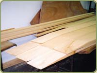 yellow cedar boards on a workbench